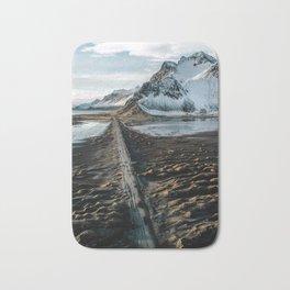 Icelandic black sand beach and mountain road - landscape photography Bath Mat