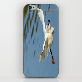 A Snowy Egret wings its way across the lake to a fishing spot iPhone Skin