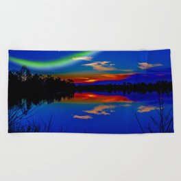 North light over a lake Beach Towel