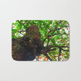 big tree with green leaves and red leaves Bath Mat