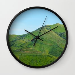 green field and green mountain with blue sky Wall Clock