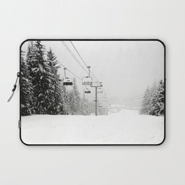 Lifts waiting for action in the snow Laptop Sleeve