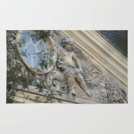Baroque angel on Parisian mansion facade Rug