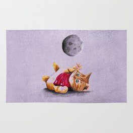 Baby Cat Playing with Moon Rug