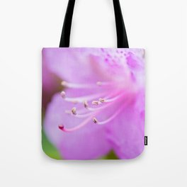 Macro shot of fresh pink rhododendron over blurred background. Shallow depth of field. Tote Bag