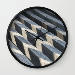 Play of light and shadow on wooden slats Wall Clock