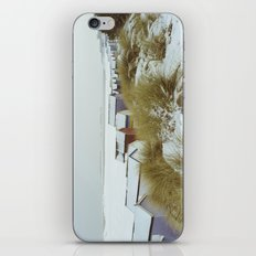 Sand dunes and beach huts in snow. Wells-next-the-sea. iPhone Skin