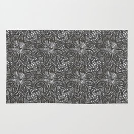 Needle point...black whitee Rug
