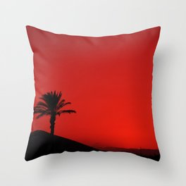 Red Andalusian sunset with silhouette palm tree and mountain Throw Pillow