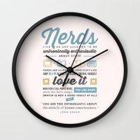 john green Wall Clocks featuring Nerds - John Green by thatfandomshop