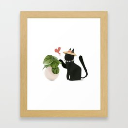 Cat playing Framed Art Print