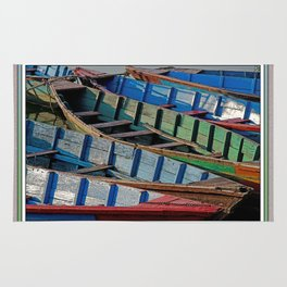 COLORFUL CANOES ALONG PHEWA LAKE SHORELINE POKHARA NEPAL Rug