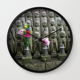 jizo statues with flowers in japan Wall Clock