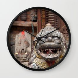 Fu with Prayer Wheels in Background Wall Clock