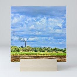 Vibrant sugar mill with smoke Mini Art Print