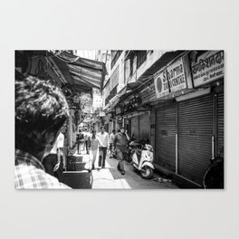 People walking in a street in Old Delhi, India Canvas Print