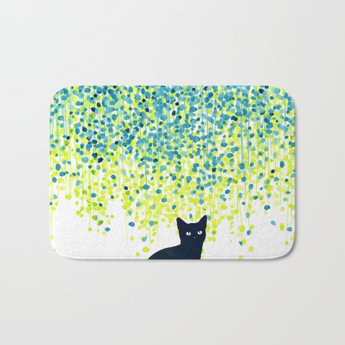Cat in the garden under willow tree Bath Mat