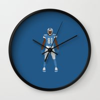 calvin and hobbes Wall Clocks featuring One Pride - Calvin Johnson by IllSports