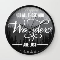 not all those who wander are lost Wall Clocks featuring Not All Those Who Wander Are Lost by Fercute