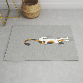 Calico Cat Hanging On Rug