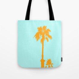Orange palm trees silhouettes on blue Tote Bag