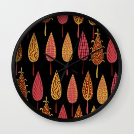 Autumn leaves on a black background . Wall Clock
