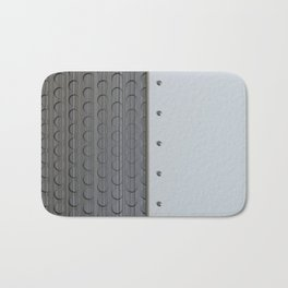 White plate with rivets and circular metal grille Bath Mat
