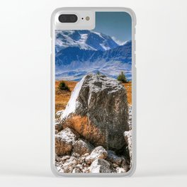 A cropping of dolomitic rocks with a range of mountains in the background Clear iPhone Case