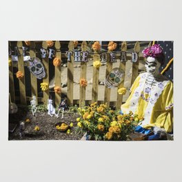 Day of the Dead Cemetery Altar with Marigolds and Frida Kahlo Skeleton Lady Rug