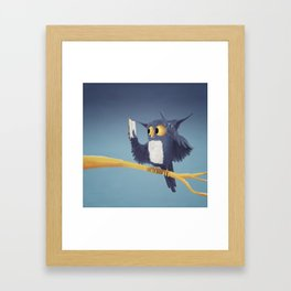 A cute owl, reading a book on a branch Framed Art Print