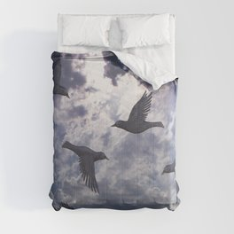crows in the stormy sky Comforters