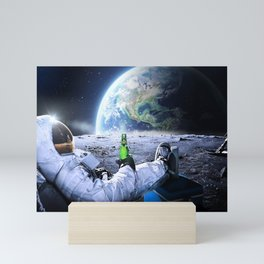 Astronaut on the Moon with beer Mini Art Print