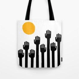 reach toward the light Tote Bag