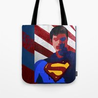 superman Tote Bags featuring Superman by Scar Design