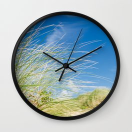 Vibrant Sand dune grasses against blue sky, Fistral Beach Wall Clock