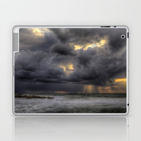 Ray of light through the clouds above the Mediterranean sea, Tel-Aviv, Israel Laptop & iPad Skin