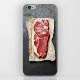 Raw beef steak on a dark slate background iPhone Skin