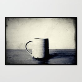 Cup of coffee on a table Canvas Print