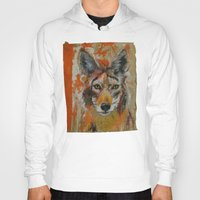 coyote Hoodies featuring Coyote by Ali Kirby