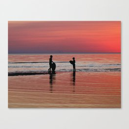Sunset Surfing Silhouettes Canvas Print