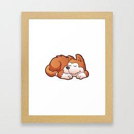 Cute puppy cartoon sleeping Framed Art Print