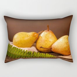 Three yellow pears and a fern on a barn wood table in front of a backdrop Rectangular Pillow