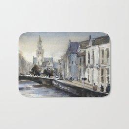 Church rising over medieval buildings of Bruges, Belgium at Jan Van Eyck Square. Bath Mat