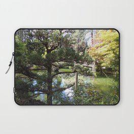 Peaceful Pond in Japanese Garden with Trees and a Bridge Laptop Sleeve