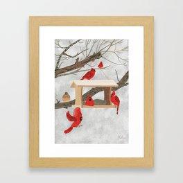 Cardinals at bird feeder Framed Art Print