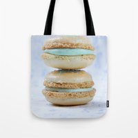 macaron Tote Bags featuring Blue macaron by Nuria Esquina