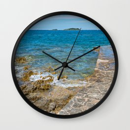 Pathway on the typical rocky beach in Istria, Croatian coast. Blue transperent sea and sky. Wall Clock