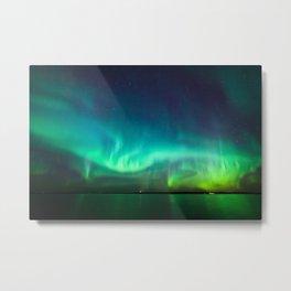 Northern lights glow over lake Metal Print