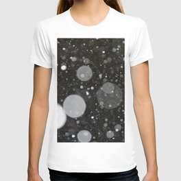Light in the Dark-Photo of light colored circles on a dark surface T-shirt