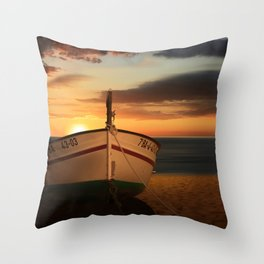 The boat in the sunset Throw Pillow